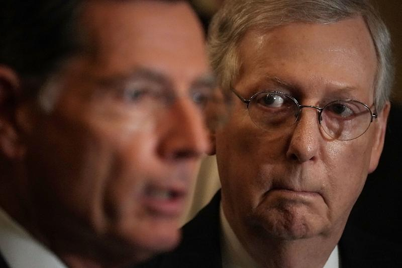 Republican Senator John Barrasso (L), seen here with Senate Majority Leader Mitch McConnell, said Trump will likely veto a bill to block his border-wall emergency if it passes (AFP Photo/ALEX WONG)