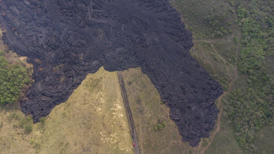 Lava flows from the Pacaya Volcano near El Patrocinio village in San Vicente Pacaya, Guatemala, Wednesday, April 21, 2021. The 8,373-foot volcano, just 30 miles south of Guatemala's capital, has been active since early February. (AP Photo/Moises Castillo)