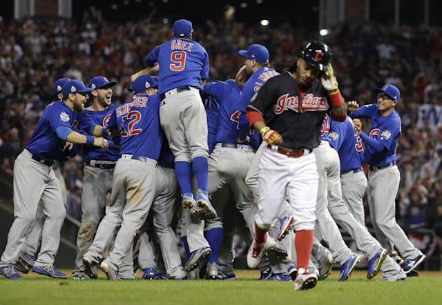 The Chicago Cubs celebrate their massive ratings win. Wait, they could also be celebrating their World Series win. You know what, I think it's that last one. (AP)