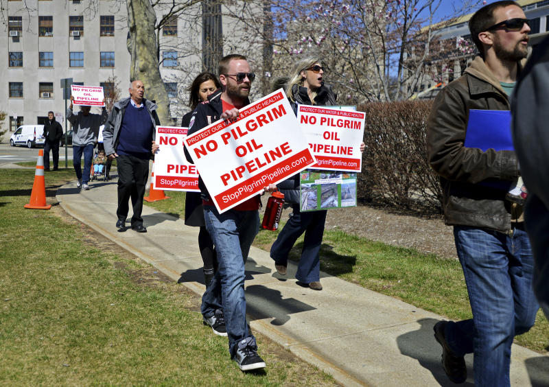 FILE - In this March 29, 2016, file photo, activists and residents from across Bergen County deliver petitions against the proposed Pilgrim Pipeline project in New York and New Jersey In Hackensack, N.J. Prolonged protests in North Dakota failed to stop the flow of oil through the Dakota Access pipeline. But they've provided inspiration for protests against pipelines around the country. Tactics used in North Dakota such as resistance camps, social media and online fundraising are now being used against pipeline projects in nearly a dozen states. (Amy Newman/The Record of Bergen County via AP, File)