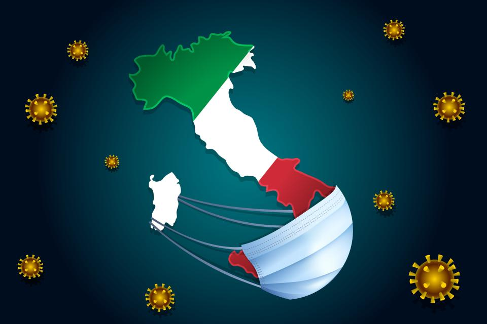 Coronavirus or Corona virus concept. Map with flag of Italy on background in a medical mask protects itself from nCoV. Viruses Around Italy. (Photo: Unimagic via Getty Images)