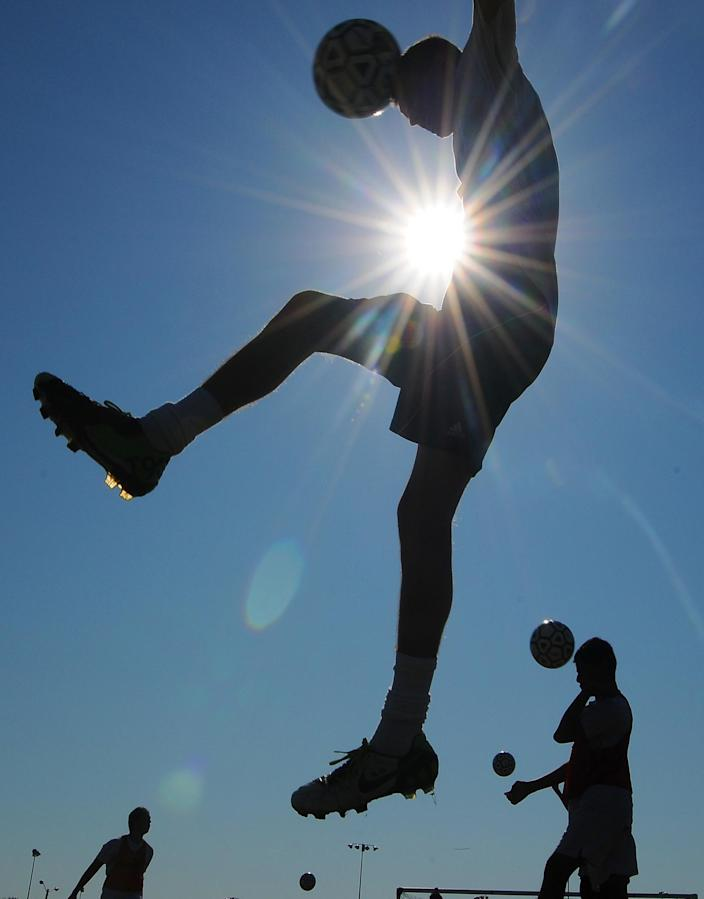 Members of the Salina South High School soccer team work out for conditioning training early Wednesday, July 20, 2011, in Salina, Kansas, to beat the heat of the day. The temperature is expected to reach 106 degrees in the Salina area. (AP Photo/Salina Journal, Tom Dorsey)