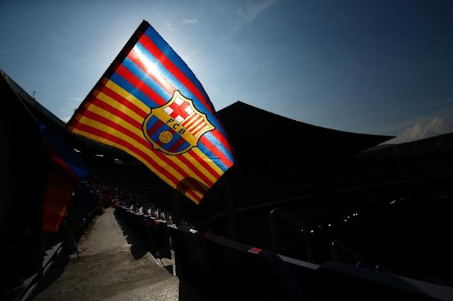 "Barcelona announced plans to redesign its club crest which will see the acronym ""FCB"" dropped to further highlight the ball and the Catalan regional flag (AFP Photo/Pau Barrena)"
