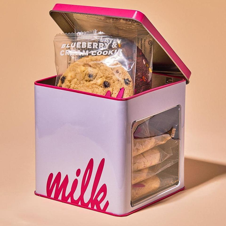 """<p><strong>Milk Bar</strong></p><p>milkbarstore.com</p><p><strong>$20.00</strong></p><p><a href=""""https://go.redirectingat.com?id=74968X1596630&url=https%3A%2F%2Fmilkbarstore.com%2Fproducts%2Fassorted-cookie-tin&sref=https%3A%2F%2Fwww.bestproducts.com%2Feats%2Ffood%2Fg2079%2Ftasty-food-gifts-for-foodies%2F"""" rel=""""nofollow noopener"""" target=""""_blank"""" data-ylk=""""slk:Shop Now"""" class=""""link rapid-noclick-resp"""">Shop Now</a></p><p>Let's be real: There is really no better foodie gift than an assortment of delicious cookies from the treat fairies over at Milk Bar. </p><p>This variety pack contains one of each of the bakery's bestsellers: A Compost Cookie, Cornflake Chocolate Chip Marshmallow Cookie, Corn Cookie, Blueberry & Cream Cookie, Chocolate Confetti Cookie, and Confetti Cookie. Consider any cookie craving covered.</p>"""
