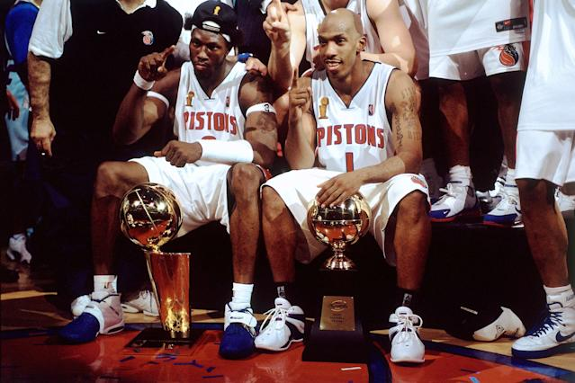 Ben Wallace has the Larry O'Brien Trophy and Chauncey Billups has his NBA Finals MVP Award. (Getty Images)