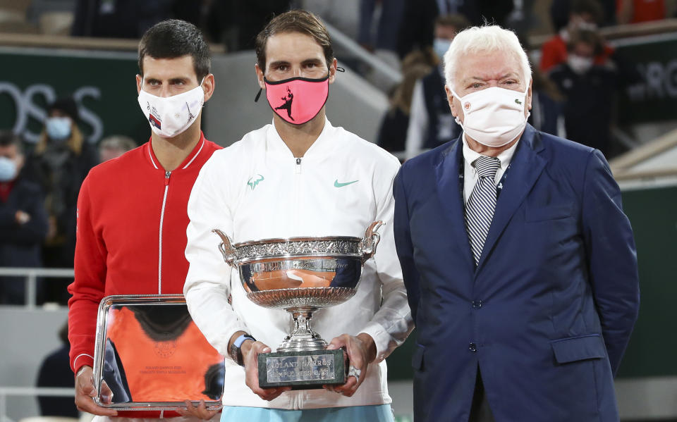 PARIS, FRANCE - OCTOBER 11: From left finalist Novak Djokovic of Serbia, winner Rafael Nadal of Spain, former tennis champion Nicola Pietrangeli during the trophy ceremony of the Men's Final on day 15 of the 2020 French Open on Court Philippe Chatrier at Roland Garros stadium on October 11, 2020 in Paris, France. (Photo by John Berry/Getty Images)