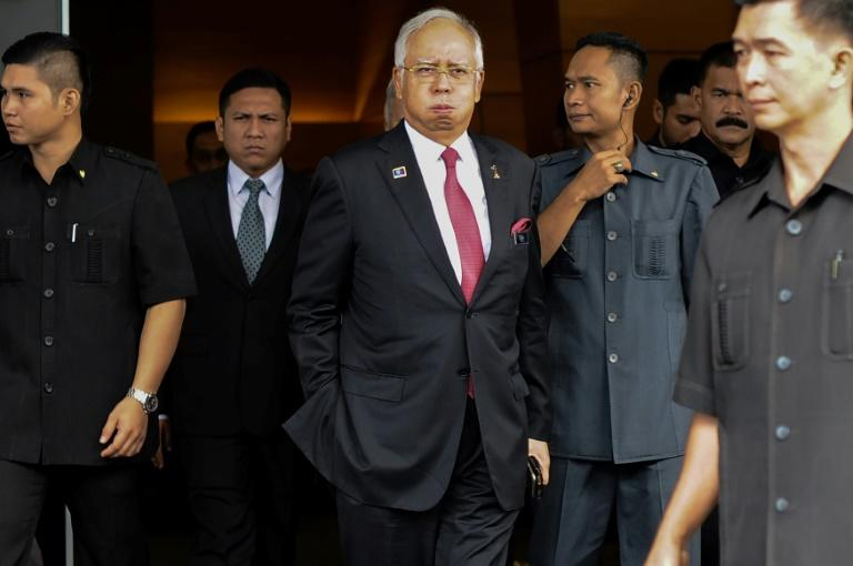 Malaysia's Najib attends cabinet meeting ahead of expected election announcement