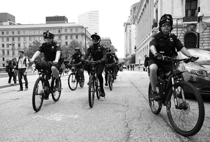 <p>Bicycle officers ride alongside anti-Trump demonstrators in Cleveland. (Photo: Khue Bui for Yahoo News)</p>