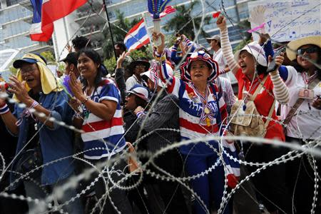 Anti-government protesters cheer as they listen to a leader's speech at a Defence Ministry compound in north Bangkok, which is serving as a temporary office for Prime Minister Yingluck Shinawatra February 19, 2014. REUTERS/Damir Sagolj