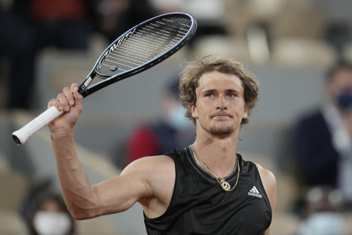 Germany's Alexander Zverev celebrates after defeating Serbia's Laslo Djere during their third round match on day 6, of the French Open tennis tournament at Roland Garros in Paris, France, Friday, June 4, 2021. (AP Photo/Christophe Ena)