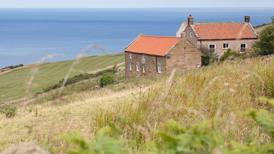 "<p>Chapel Cottage is a fine example of the local Robin Hood's Bay distinctive style of architecture, with its red pantile roof and stone exterior. The pretty, two-bedroom Christmas cottage boasts uninterrupted views across a vast sandy beach and out to sea. It also has a lovely garden.</p><p><strong>Be sure to... </strong>Head out and explore the coast on your doorstep. The walk to Robin Hood's Bay is an eight-mile round-trip with great views along the cliffs and back along the beach. </p><p><strong>Sleeps: </strong>4</p><p><strong>Pets: </strong>Yes</p><p><strong>Price: </strong>£617 for 3 nights over Christmas (unavailable for New Year's Eve)</p><p><a class=""link rapid-noclick-resp"" href=""https://go.redirectingat.com?id=127X1599956&url=https%3A%2F%2Fwww.nationaltrust.org.uk%2Fholidays%2Fchapel-cottage-yorkshire&sref=https%3A%2F%2Fwww.countryliving.com%2Fuk%2Ftravel-ideas%2Fstaycation-uk%2Fg33888029%2Fchristmas-cottage%2F"" rel=""nofollow noopener"" target=""_blank"" data-ylk=""slk:FIND OUT MORE"">FIND OUT MORE</a><br></p>"
