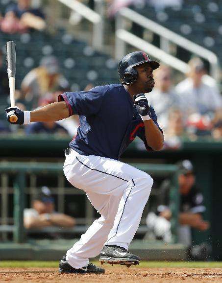 Cleveland Indians' Michael Bourn bats against the Chicago White Sox during an exhibition baseball game in Goodyear, Ariz., Tuesday, March 4, 2014. (AP Photo/Paul Sancya)