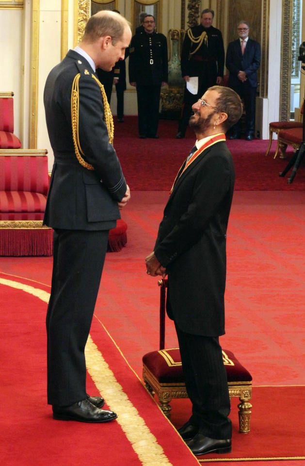 <p> Former Beatle Ringo Starr, speaks with Britain's Prince William after receiving his knighthood at Buckingham Palace during an Investiture ceremony in London Tuesday March 20, 2018. (Yui Mok/PA via AP) </p>