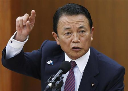 Japan's Finance Minister Taro Aso speaks during a semi-annual parliament hearing on monetary policy in Tokyo