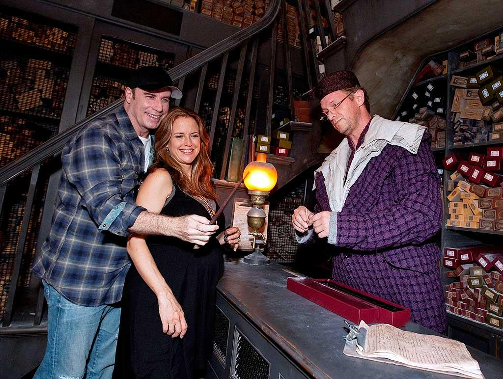 """Also sporting a burgeoning belly was 47-year-old actress Kelly Preston, who was glowing during a visit to The Wizarding World of Harry Potter at the Universal Orlando Resort with her husband John Travolta last Sunday. Who knew they were Harry Potter fans?! Universal Orlando/<a href=""""http://www.splashnewsonline.com"""" target=""""new"""">Splash News</a> - September 5, 2010"""