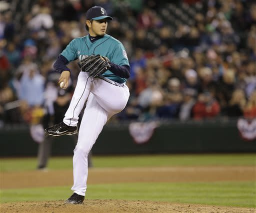 Seattle Mariners starting pitcher Hisashi Iwakuma throws against the Texas Rangers in the sixth inning of a baseball game, Friday, April 12, 2013, in Seattle. (AP Photo/Ted S. Warren)