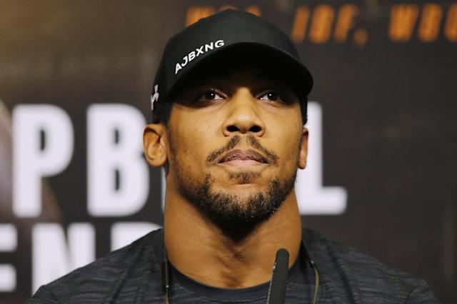 Britain's Anthony Joshua has called for tougher guidelines on drugs cheats (AFP Photo/Tolga AKMEN)