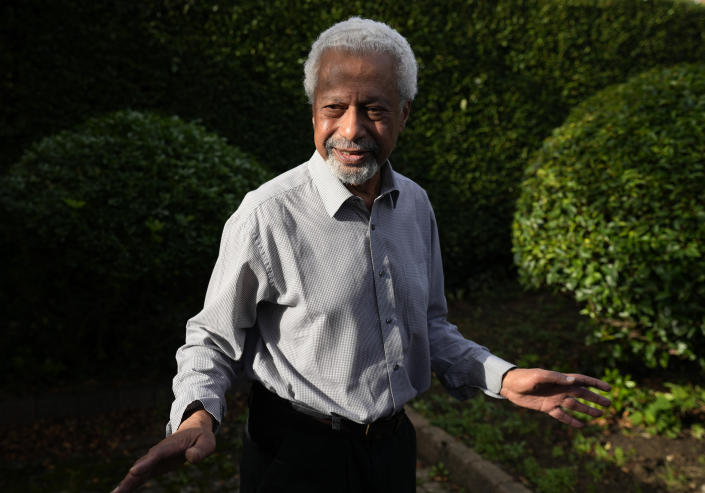 """Tanzanian writer Abdulrazak Gurnah gestures as he poses for a photo at his home in Canterbury, England, Thursday, Oct. 7, 2021. Gurnah was awarded the Nobel Prize for Literature earlier on Thursday. The Swedish Academy said the award was in recognition of his """"uncompromising and compassionate penetration of the effects of colonialism."""" (AP Photo/Frank Augstein)"""