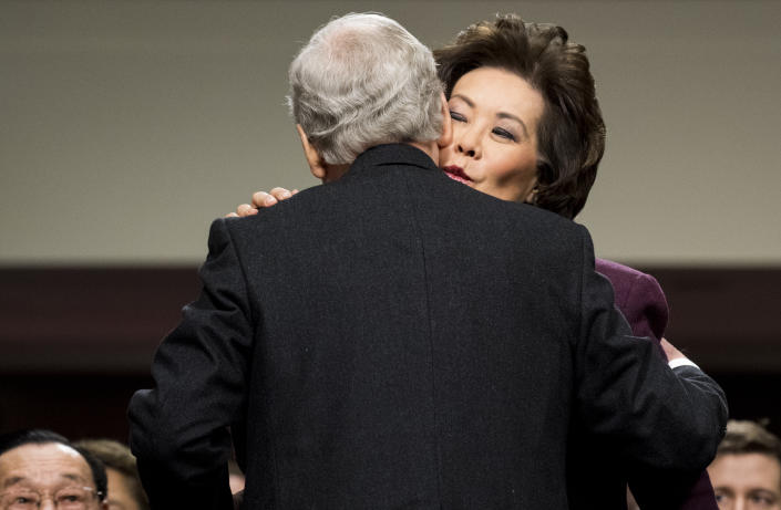 At her confirmation hearing on Jan. 11, 2017, Secretary of Transportation nominee Chao gives her husband, Senate Majority Leader Mitch McConnell, a kiss after introducing her. (Photo: Bill Clark/CQ Roll Call via Getty Images)