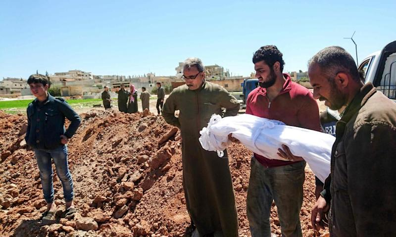 Syrians bury the bodies of victims of a chemical weapons attack in Khan Sheikhun.