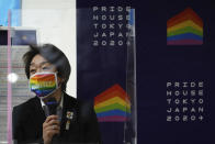 """Tokyo 2020 Organizing Committee President Seiko Hashimoto wearing a rainbow-colored mask with word """"Equality"""" speaks during her visit to Pride House Tokyo Legacy in Tokyo Tuesday, April 27, 2021. Japan marked LGBTQ week with pledge to push for equality law before the Olympics. (AP Photo/Eugene Hoshiko, Pool)"""
