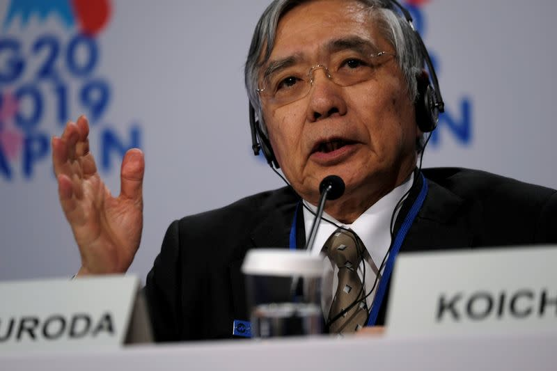 Bank of Japan Governor Haruhiko Kuroda takes questions from reporters at the annual meetings of the International Monetary Fund and World Bank in Washington