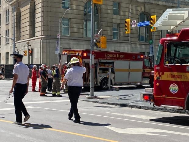 Emergency crews are investigating after a crane fell onto a building near Yonge Street and The Esplanade. (Courtesy of Hendrik Pape - image credit)