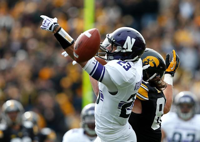Northwesterns' Nick VanHoose (23) breaks up a pass intended for Iowa's Ray Hamilton (82) during the first half of an NCAA college football game Saturday, Oct. 26, 2013, in Iowa City, Iowa. (AP Photo/Brian Ray)