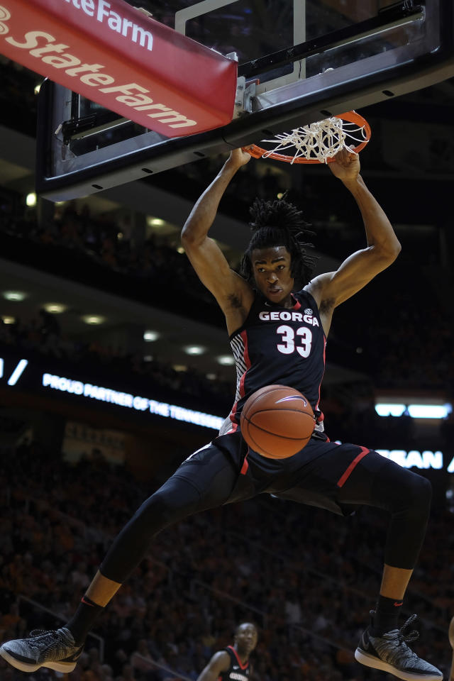 FILE - In this Jan. 5, 2019, file photo, Georgia forward Nicolas Claxton (33) dunks the ball in the first half of an NCAA college basketball game against Tennessee, in Knoxville, Tenn. Claxton is an NBA draft first-round prospect who thrived last season (13.0 points, 8.6 rebounds) while measuring at nearly 7-0 with a nearly 7-3 wingspan. (AP Photo/Shawn Millsaps, File)