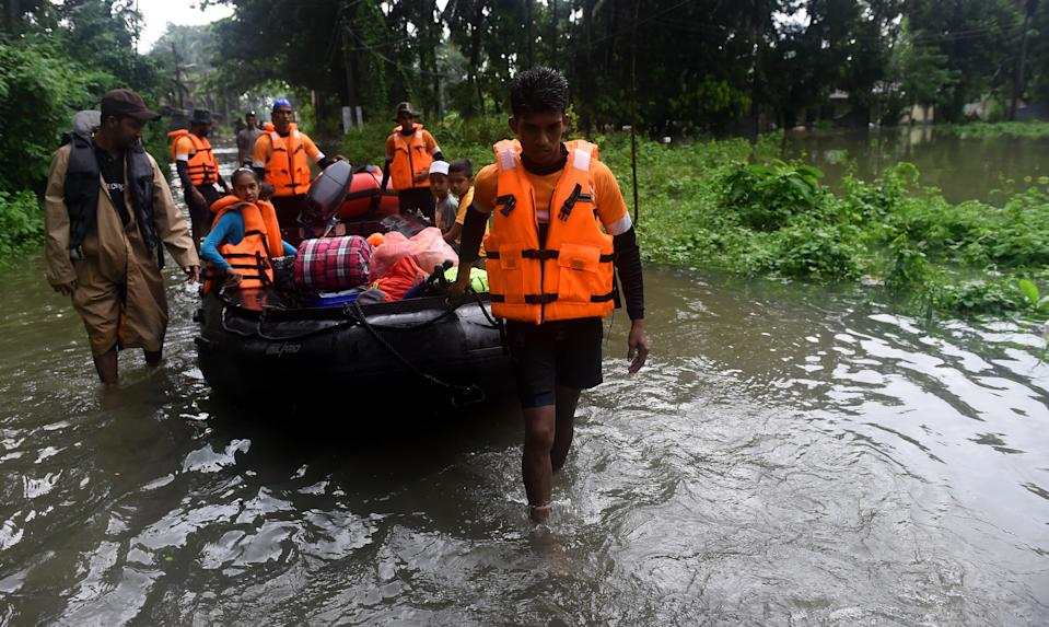 The Indian Ocean island has witnessed erratic rainfall over the last few years, which has led to drought and crop failures. This year saw cyclone Amphan batter Sri Lanka, bringing heavy rainfall and winds, triggering floods and landslides and affecting 2,000 people. <br><br>In 2018, severe monsoon rainfall in May affected the south and west coast of Sri Lanka, triggering floods killing atleast 24 people and displacing nearly 6,000.<em><strong><br><br>Image</strong></em><strong>: </strong>Sri Lankan navy personnel evacuate residents following flooding in the Malwana, just outside the capital Colombo, on May 23, 2018 as monsoon rains lashed large parts of the island. (Photo by Ishara S. KODIKARA / AFP) (Photo credit should read ISHARA S. KODIKARA/AFP via Getty Images)