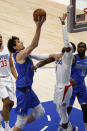 Dallas Mavericks center Boban Marjanovic (51) scores as he is defended by Los Angeles Clippers guard Reggie Jackson (1) in the first half during Game 6 of an NBA basketball first-round playoff series in Dallas, Friday, June 4, 2021. (AP Photo/Michael Ainsworth)