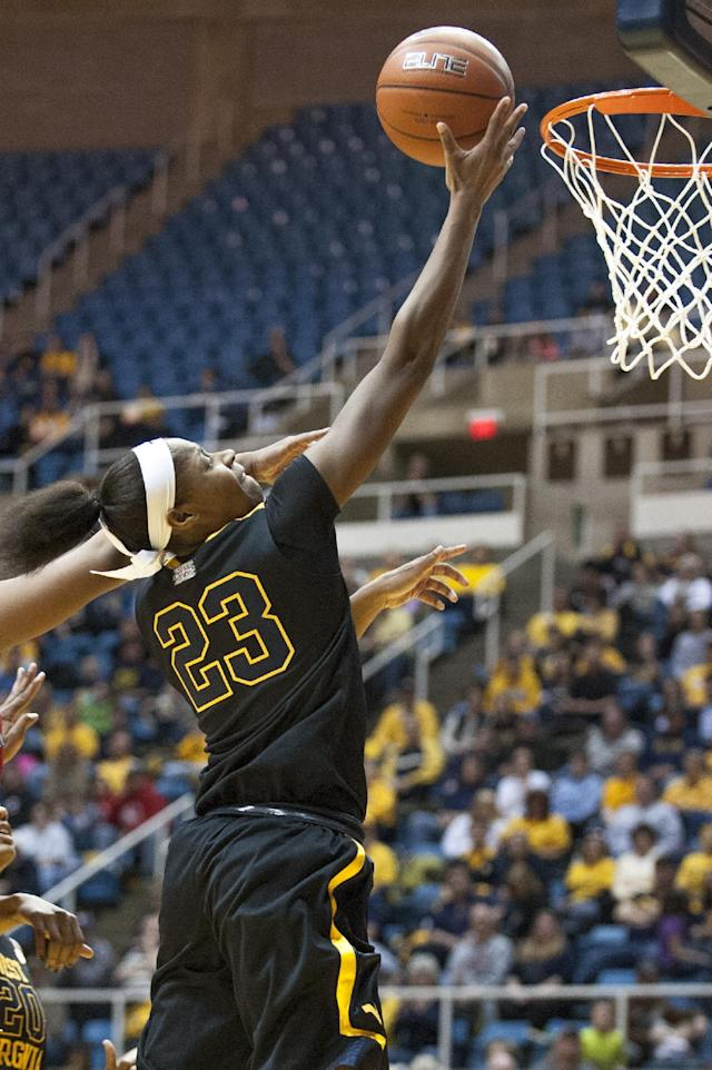 West Virginia's Bria Holmes (23) drives to the basket during the second half of an NCAA college basketball game against Kansas, Tuesday, March 4, 2014, in Morgantown, W.Va. West Virginia won 67-60. (AP Photo/Andrew Ferguson)