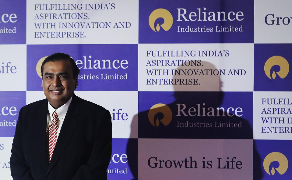 Mukesh Ambani, chairman of Reliance Industries Limited, poses for photographers before addressing the annual shareholders meeting in Mumbai June 6, 2013. India's Reliance Industries Ltd plans to invest 1.5 trillion rupees ($26.4 billion) in its businesses over three years, Ambani told shareholders on Thursday. REUTERS/Danish Siddiqui (INDIA - Tags: BUSINESS)