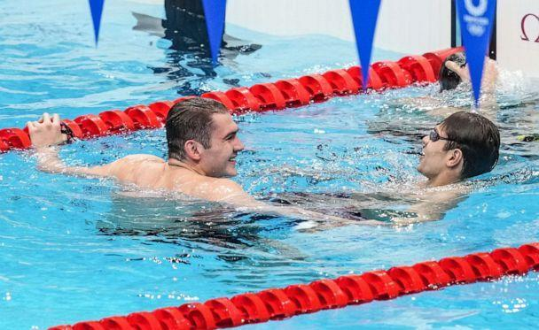 PHOTO: Evgeny Rylov (R) and Kliment Kolesnikov (L) of ROC celebrate after winning the gold and silver medals in the final of the men's 100m backstroke swimming during the 2020 Olympic Games in Tokyo, July 27, 2021. (Anadolu Agency via Getty Images)