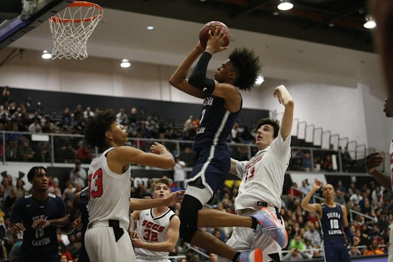 Sierra Canyon's BJ Boston goes up against Santa Clarita Christian's Kaleb Lowery, left, and Caden Starr during a game at CSUN's Matadome.