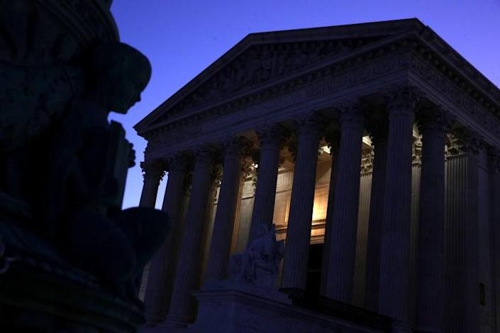 """Lights glows from the U.S. Supreme Court building in Washington during the early morning hours of Sept. 16, 2019. <span class=""""copyright"""">(Alex Wong / Getty Images)</span>"""