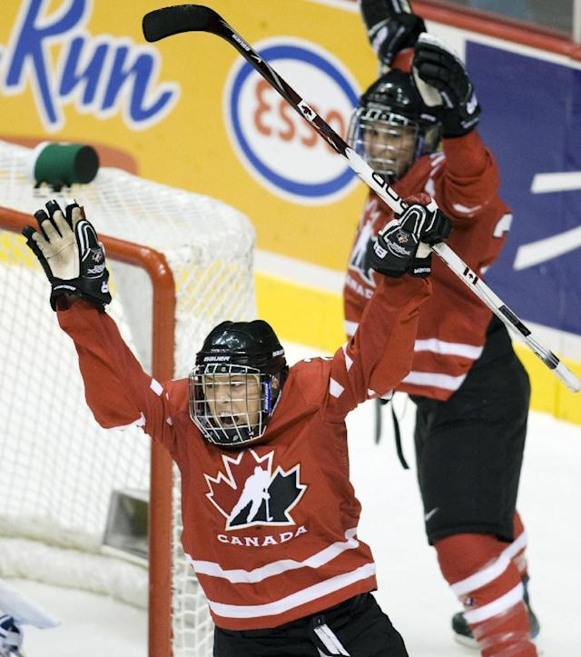 FILE - In this Sept. 6, 2009, file photo, Team Canada's Meghan Agosta, foreground, celebrates her first period goal against the United States as teammate Marie-Philip Poulin, right, looks on during the gold medal match at the Hockey Canada Cup tournament in Vancouver. (AP Photo/The Canadian Press, Jonathan Hayward, File