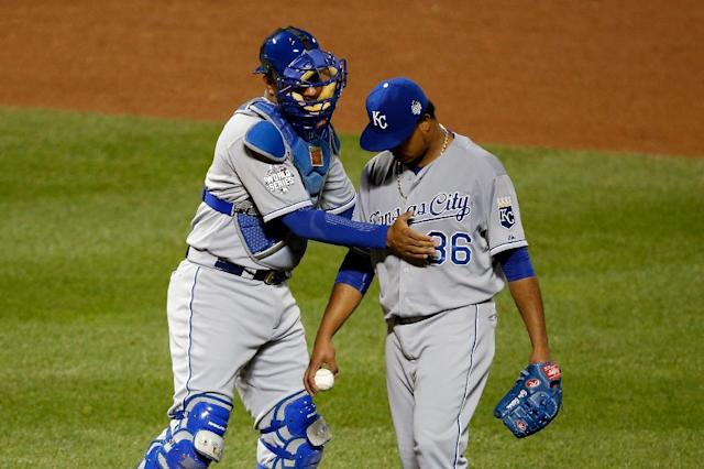 Kansas City Royals' Salvador Perez (L) greets teammate Edinson Volquez during the game against the New York Mets in Game Five of the 2015 World Series at Citi Field on November 1, 2015 (AFP Photo/Sean M. Haffey)