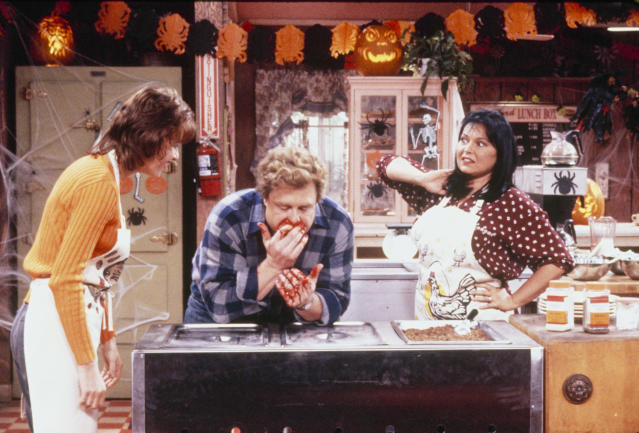 "Sandra Bernhard, John Goodman, and Roseanne Barr in the ""Halloween IV"" episode of <em>Roseanne </em>(Photo: ABC)"