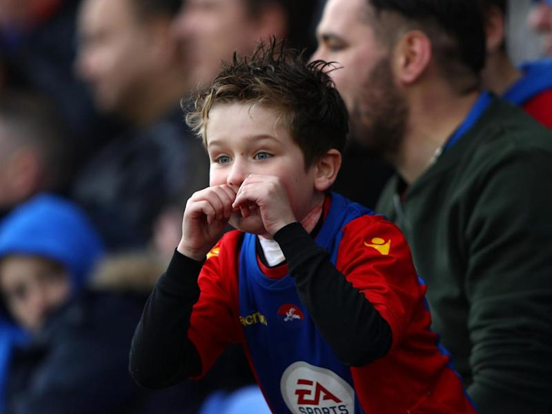 A young Palace supporter enjoying the action (Getty)