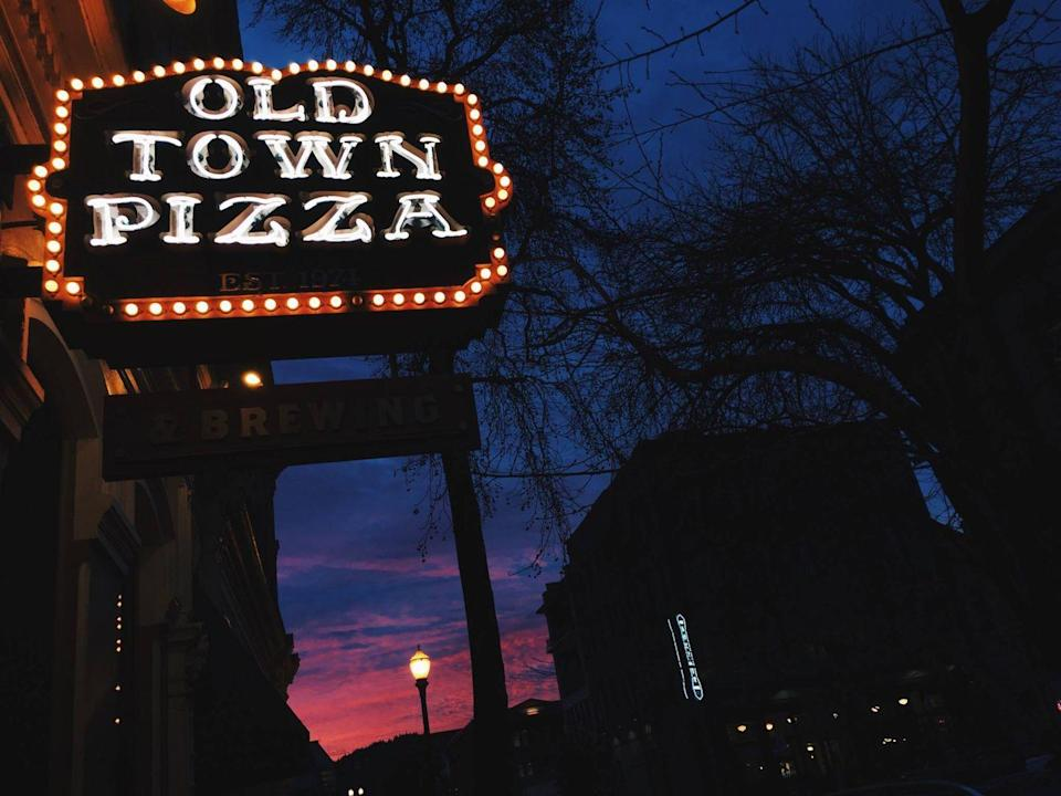 """<p>Founded in 1974, <a href=""""https://www.otbrewing.com/"""" rel=""""nofollow noopener"""" target=""""_blank"""" data-ylk=""""slk:Old Town Pizza and Brewing"""" class=""""link rapid-noclick-resp"""">Old Town Pizza and Brewing</a> truly is old—it's in the lobby of the Merchant Hotel, which is one of the longest-standing buildings in Portland. It's haunted by a ghost named Nina who has been there for over a century and is usually wearing a black dress, hanging out in the basement, or even standing near guests as they eat. Supposedly, Nina was killed and left in the elevator shaft on the premises. The place even serves a Ghost Pie! </p><p><em>Photo Credit: Facebook/<a href=""""https://www.facebook.com/100847979468/photos/a.10150539418714469/10155031737794469/?type=3&theater"""" rel=""""nofollow noopener"""" target=""""_blank"""" data-ylk=""""slk:Old Town Pizza"""" class=""""link rapid-noclick-resp"""">Old Town Pizza</a></em></p>"""