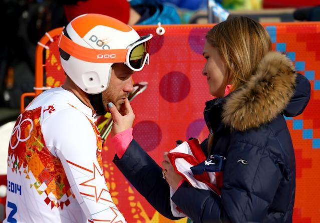 SOCHI, RUSSIA - FEBRUARY 16: Morgan Miller (R) comforts her husband Bode Miller of the United States during the Alpine Skiing Men's Super-G on day 9 of the Sochi 2014 Winter Olympics at Rosa Khutor Alpine Center on February 16, 2014 in Sochi, Russia. (Photo by Doug Pensinger/Getty Images)