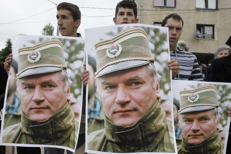 Bosnian Serb people holding photos of former Gen. Ratko Mladic during a protest in Kalinovik, Bosnia, hometown of the Bosnian Serb wartime military leader, 70 kms southeast of Sarajevo, Sunday, May 29, 2011. Approximately 3,000 Bosnian Serbs, gathered to show support and anger after the arrest of Mladic. Protestors carried banners and flags and sang songs in his support, he was arrested after 16 years in hiding from the International War Crimes Tribunal in the Hague. Mladic is to face trial on 15 accounts of war crimes including genocide in Srebrenica in 1995. (AP Photo/Amel Emric)