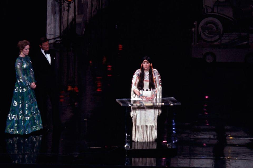 "<p>Sacheen Littlefeather<span class=""redactor-invisible-space""> took the stage to refuse Marlon Brando's Oscar on his behalf saying, ""I'm representing Marlon Brando this evening and he has asked me to tell you ... that he very regretfully cannot accept this very generous award. And the reasons for this being are the treatment of American Indians today by the film industry.""<span class=""redactor-invisible-space""> The full statement ran in <em>The New York Times</em> the following day after Sacheen was cut off because of time.</span></span></p><p><span class=""redactor-invisible-space""><span class=""redactor-invisible-space""><strong>RELATED:</strong> <a href=""https://www.goodhousekeeping.com/life/entertainment/g5148/oscar-scandals/"" rel=""nofollow noopener"" target=""_blank"" data-ylk=""slk:All of the Most Scandalous Moments in Oscars History"" class=""link rapid-noclick-resp"">All of the Most Scandalous Moments in Oscars History</a><br></span></span></p>"