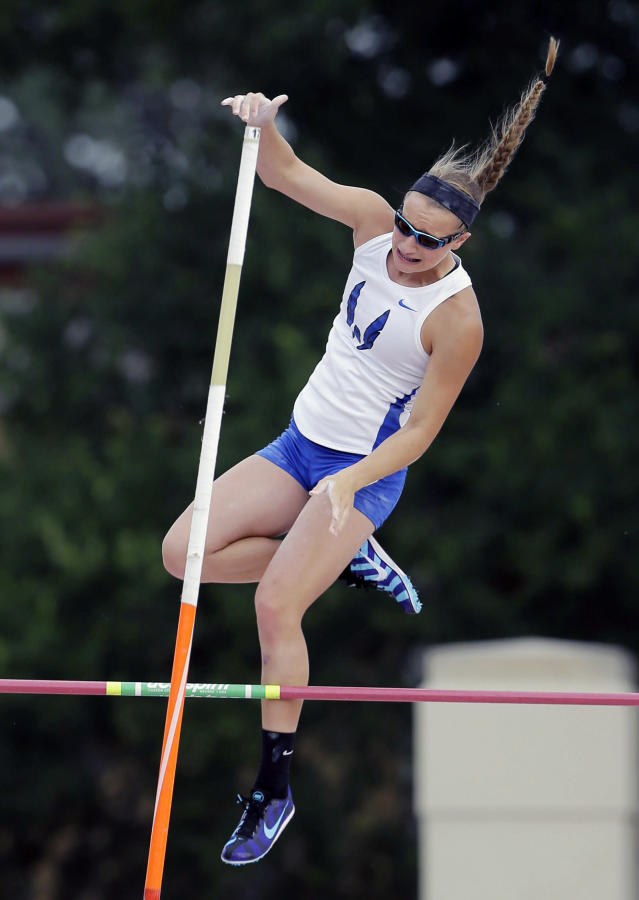 Emory Rains High School's Charlotte Brown competes in the Girls 3A pole vault at the UIL State Track & Field meet, Friday, May 9, 2014, in Austin, Texas. Brown, a pole vaulter who happens to be legally blind, starts on the clap from her coach and counts her steps on her approach. (AP Photo/Eric Gay)