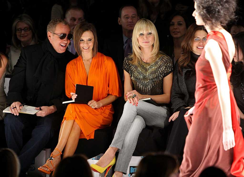 """Victoria Beckham flashed a rare smile during the """"Project Runway"""" Season 4 Fall 2008 fashion show on Friday. Posh sat alongside regular judges Nina Garcia (not pictured), Michael Kors (left), and Heidi Klum (right). Although only three designers made the finals of the popular reality show, five collections were shown to prevent viewers from being spoiled. Stephen Lovekin/<a href=""""http://www.gettyimages.com/"""" target=""""new"""">Getty Images for IMG</a> - February 8, 2008"""