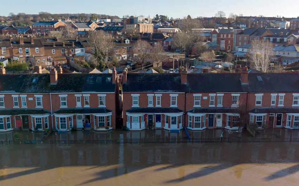 An aerial view of a row of residential houses submerged by flood water on January 22,2021 in Worcester, England - Getty