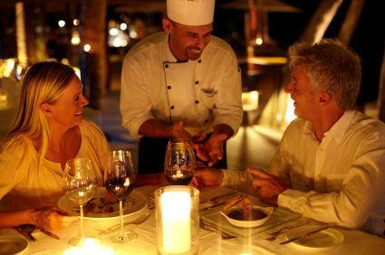 chef talking to couple at upscale restaurant