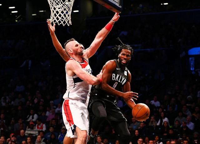 Dec 22, 2017; Brooklyn, NY, USA; Brooklyn Nets forward DeMarre Carroll (9) grabs a rebound against Washington Wizards center Marcin Gortat (13) during the second half at Barclays Center. Mandatory Credit: Andy Marlin-USA TODAY Sports TPX IMAGES OF THE DAY