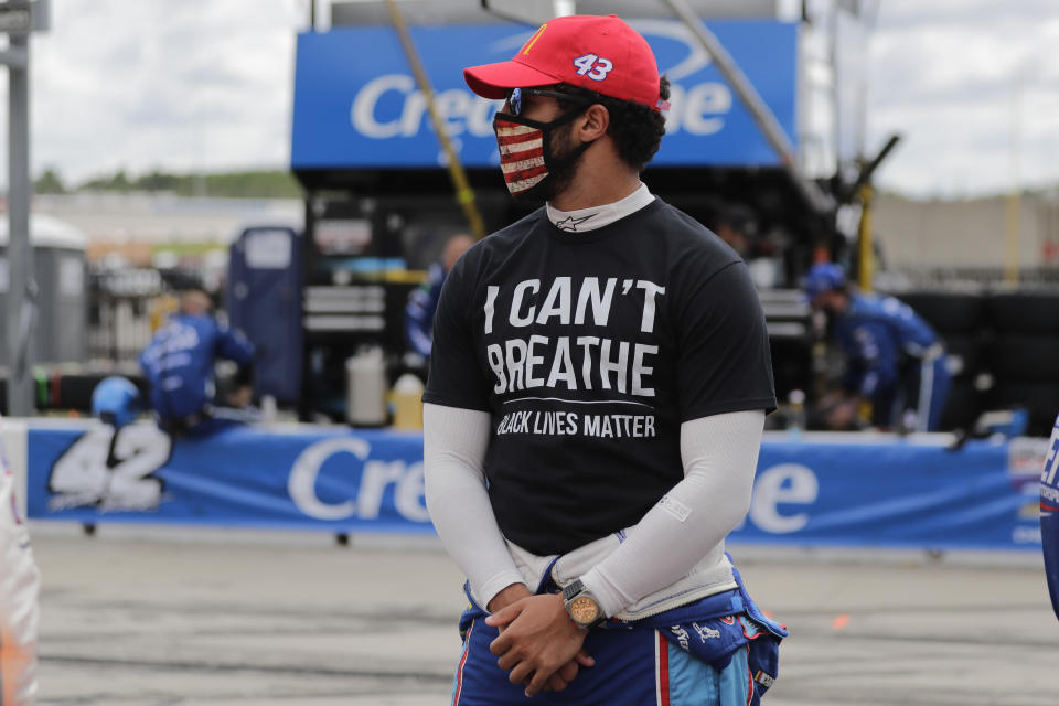 "Bubba Wallace (43) wears a ""I Can't Breath, Black Lives Matter"" shirt before a NASCAR Cup Series auto race at Atlanta Motor Speedway, Sunday, June 7, 2020, in Hampton, Ga. (AP Photo/Brynn Anderson)"